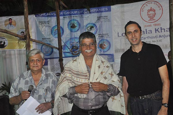 Lonavala trustee Adi Banajee (center) felicitated by trustees Percy Master (left) and Saroosh Dinshaw