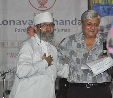 Lonavala agiary's Ervad Zarir Tata receiving shawl from Percy Master