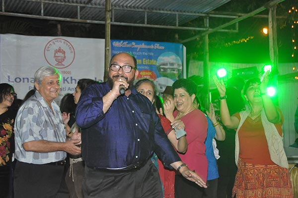 Caterer Adil Bhesadia belting out a tune with dancers in the background